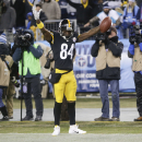 Pittsburgh Steelers wide receiver Antonio Brown celebrates after he scored a touchdown on a 12-yard pass against the Tennessee Titans in the second half of an NFL football game Monday, Nov. 17, 2014, in Nashville, Tenn.(AP Photo/Wade Payne)