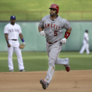 Los Angeles Angels Albert Pujols (5) runs the bases after his solo home run as Texas Rangers shortstop Elvis Andrus, left, looks on in the background during the fourth inning of a baseball game in Arlington, Texas, Sunday, July 5, 2015. (AP Photo/LM Otero)