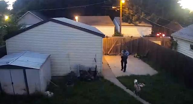 Police Officer Caught On Surveillance Camera Shooting 2 Dogs In Yard