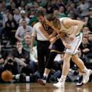 BOSTON, MA - APRIL 26: Kevin Love #0 of the Cleveland Cavaliers injures his shoulder as he chases a loose ball against Kelly Olynyk #41 of the Boston Celtics in the first half in Game Four during the first round of the 2015 NBA Playoffs on April 26, 2015 at TD Garden in Boston, Massachusetts. Love was injured on the play. (Photo by Jim Rogash/Getty Images)