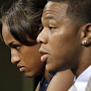 FILE - In this May 23, 2014, file photo, Janay Rice, left, looks on as her husband, Baltimore Ravens running back Ray Rice, speaks to the media during an news conference in Owings Mills, Md. Rice starts his two-game suspension Saturday, Aug. 30, 2014, missing the Ravens' home opener against Cincinnati and a key AFC North showdown in Pittsburgh. (AP Photo/Patrick Semansky, File)