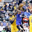 INDIANAPOLIS, IN - MARCH 01:  Roy Hibbert #55 of the Indiana Pacers blocks the shot of Thomas Robinson #41 of the Philadelphia 76ers during the game at Bankers Life Fieldhouse on March 1, 2015 in Indianapolis, Indiana. NOTE TO USER: User expressly acknowledges and agrees that, by downloading and or using this Photograph, user is consenting to the terms and conditions of the Getty Images License Agreement.  (Photo by Andy Lyons/Getty Images)