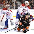 ANAHEIM, CA - MARCH 04:  Tomas Fleischmann #14 of the Anaheim Ducks is knocked to the ice by Jeff Petry #26 of the Montreal Canadiens in front of Carey Price #31 during a 3-1 Ducks in at Honda Center on March 4, 2015 in Anaheim, California.  (Photo by Harry How/Getty Images)