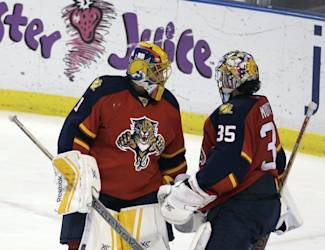 Florida Panthers starting goalie Roberto Luongo (1) replaces injured goalie Al Montoya (35) during the third period of an NHL hockey game against the Toronto Maple Leafs, Tuesday, March 3, 2015, in Sunrise, Fla. The Maple Leafs won 3-2. (AP Photo/Luis M. Alvarez)