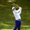 Northern Ireland's Rory McIlroy plays a shot during day one of the BMW PGA Championship at Wentworth golf club, Virginia Water, England, Thursday May 21, 2015. (Adam Davy/PA via AP) UNITED KINGDOM OUT NO SALES NO ARCHIVE