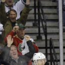 Minnesota Wild right wing Jason Pominville, right, and teammate Zach Parise, left, celebrate Pominville's goal on St. Louis Blues goalie Jake Allen during the second period of Game 3 of an NHL hockey first-round playoff series game in St. Paul, Minn., Monday, April 20, 2015. (AP Photo/Ann Heisenfelt)