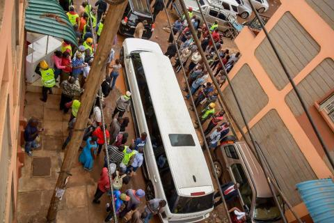 SportPesa Jackpot winner Samuel Abisai being escorted in a limousine