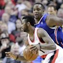 Portland Trail Blazers forward Dorell Wright, left, drives to the hoop past Los Angeles Clippers forward Glen Davis during the first half of an NBA basketball game in Portland, Ore., Wednesday, April 16, 2014. (AP Photo/Don Ryan)