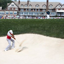 Jul 28, 2016; Springfield, NJ, USA; PGA golfer Jason Day hits out of a sand trap while Rory McIlroy watches on the 18th hole during the first round of the 2016 PGA Championship golf tournament at Baltusrol GC - Lower Course. Brian Spurlock-USA TODAY Sports