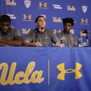 Who will pay for the expenses the UCLA three incurred while detained in China?