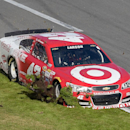 Kyle Larson (42) digs up the infield grass while driving down pit road for a pit stop during the Daytona 500 NASCAR Sprint Cup series auto race at Daytona International Speedway, Sunday, Feb. 22, 2015, in Daytona Beach, Fla.(AP Photo/Phelan M. Ebenhack)