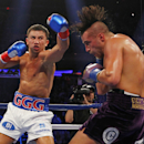 Gennady Golovkin, left, hits David Lemieux in the second round of a middleweight title fight at Madison Square Garden in New York on Saturday, Oct. 17, 2015. Golovkin won in the eighth round. (AP Photo/Rich Schultz)