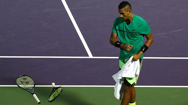 Kyrgios walks to his bouncing racquets. Pic Getty
