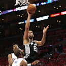 LOS ANGELES, CA - MAY 02: Tim Duncan #21 of the San Antonio Spurs shoots over Chris Paul #3 and DeAndre Jordan #6 of the Los Angeles Clippers during Game Seven of the Western Conference quarterfinals of the 2015 NBA Playoffs at Staples Center on May 2, 2015 in Los Angeles, California. The Clippers won 111-109 to win the series four games to three. (Photo by Stephen Dunn/Getty Images)