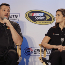 Driver Tony Stewart, left, speaks to the media as Danica Patrick, right, listens during the NASCAR Charlotte Motor Speedway media tour in Charlotte, N.C., Tuesday, Jan. 27, 2015. (AP Photo/Chuck Burton)