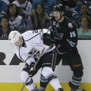 Los Angeles Kings' Slava Voynov, left, and San Jose Sharks' James Sheppard vie for the puck during the first period of Game 1 of an NHL hockey first-round playoff series Thursday, April 17, 2014, in San Jose, Calif. (AP Photo/Ben Margot)