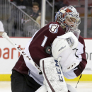 Colorado Avalanche goalie Semyon Varlamov, of Russia, makes a save on a shot by the New Jersey Devils during the second period of an NHL hockey game, Saturday, Nov. 15, 2014, in Newark, N.J. (AP Photo/Julio Cortez)