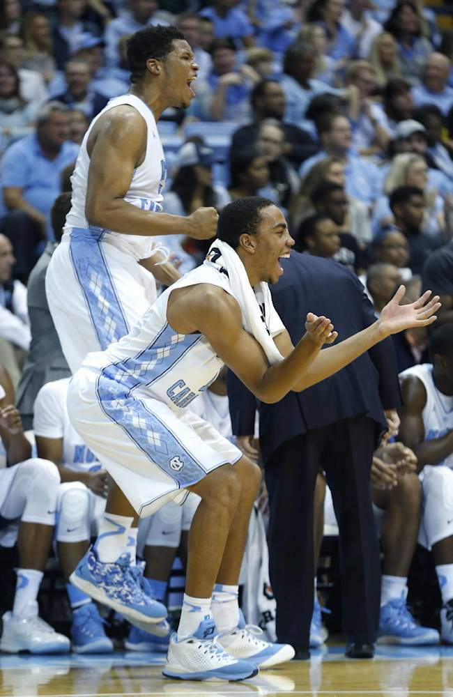 Carolina s Brice Johnson  front and Kennedy Meeks celebrate a dunk    Kennedy Meeks Dunk