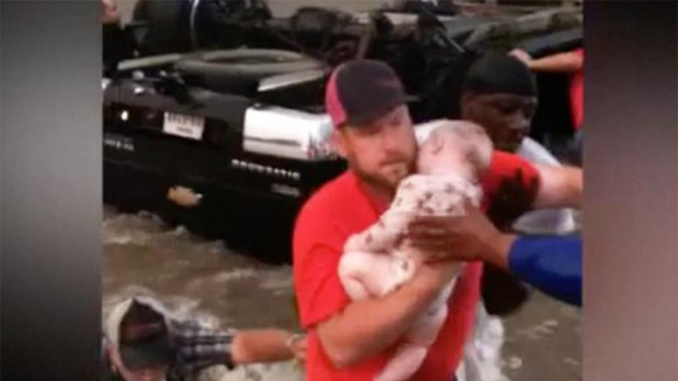 Family stuck in flooded overturned truck meets man who saved baby's life