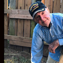 WWII vet, 97, takes a knee to support NFL players (Yahoo Sports)