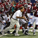 Alabama head coach Nick Saban and the Crimson Tide take the field to warm up up before an NCAA college football game against West Virginia Saturday, Aug. 30, 2014, in Atlanta. (AP Photo/John Bazemore)