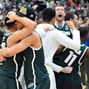 Mar 29, 2015; Syracuse, NY, USA; Michigan State Spartans guard Bryn Forbes (5) and guard Travis Trice (20) celebrates after the game against the Louisville Cardinals in the finals of the east regional of the 2015 NCAA Tournament at Carrier Dome. Michigan State Spartans won 76-70. (Rich Barnes-USA TODAY Sports)