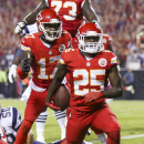Kansas City Chiefs running back Jamaal Charles, right, is congratulated by teammate Donnie Avery, left, after catching a 5-yard pass for a touchdown during the second quarter of an NFL football game against the New England Patriots Monday, Sept. 29, 2014, in Kansas City, Mo. (AP Photo/Ed Zurga)