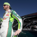 Dale Earnhardt Jr. stands by his car as he waits to start the NASCAR Sprint Cup Series auto race at Talladega Superspeedway, Sunday, Oct. 19, 2014, in Talladega, Ala. (AP Photo/John Bazemore)