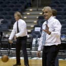 New York investment firm executives Marc Lasry, left, and Wesley Edens shoot baskets in the Bradley Center before a news conference with Milwaukee Bucks owner Herb Kohl after reaching a deal to sell the franchise Wednesday, April 16, 2014, in Milwaukee. (AP Photo/Morry Gash)