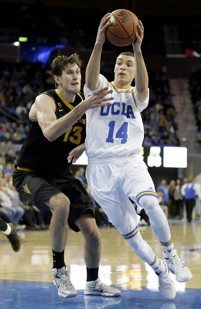 UCLA guard Zach LaVine, right, drives to the basket around Arizona State center Jordan Bachynski during the second half of an NCAA college basketball game in Los Angeles, Sunday, Jan. 12, 2014