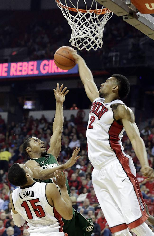 UNLV's Khem Birch, of Canada, right, blocks a short from Colorado State's Carlton Hurst during the first half of an NCAA college basketball game on Wednesday, Feb. 26, 2014, in Las Vegas