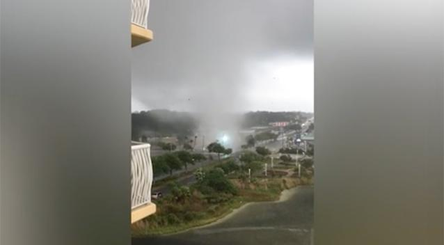 Watch powerful waterspout churn through Florida beach