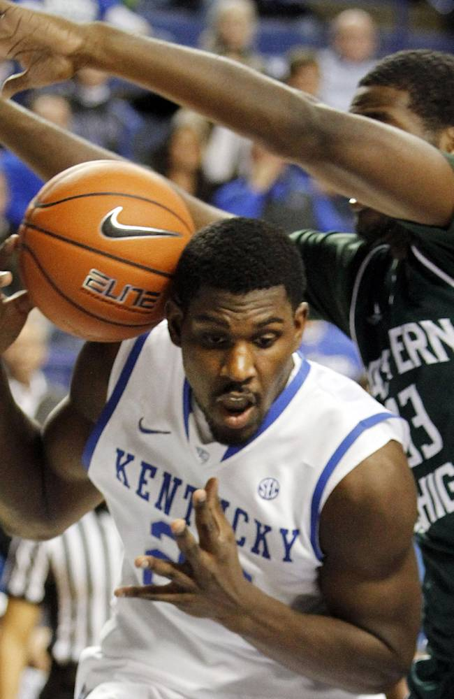 Kentucky's Alex Poythress, left, and Eastern Michigan's Anthony Strickland go after a loose ball during the second half of an NCAA college basketball game on Wednesday, Nov. 27, 2013, in Lexington, Ky. Kentucky won 81-63