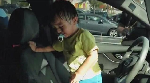 Dramatic moment child rescued from vehicle  after locking himself in it