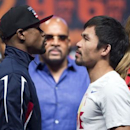 Undefeated WBC/WBA welterweight champion Floyd Mayweather Jr. (L) of the U.S. and WBO welterweight champion Manny Pacquiao of the Philippines face off during an official weigh-in at the MGM Grand Garden Arena in Las Vegas, Nevada May 1, 2015.  REUTERS/Steve Marcus