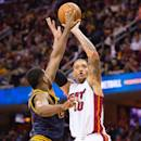 CLEVELAND, OH - APRIL 2: Tristan Thompson #13 of the Cleveland Cavaliers tries to block Michael Beasley #30 of the Miami Heat during the first half at Quicken Loans Arena on April 2, 2015 in Cleveland, Ohio. (Photo by Jason Miller/Getty Images)