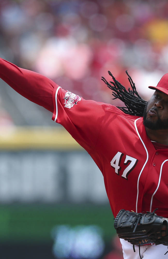 Cueto goes 8 innings, Reds beat Twins 2-1 to take series