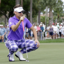 Ian Poulter, of England, lines up the ball at the third hole during the third round of the Honda Classic golf tournament, Sunday, March 1, 2015, in Palm Beach Gardens, Fla. (AP Photo/Alan Diaz)
