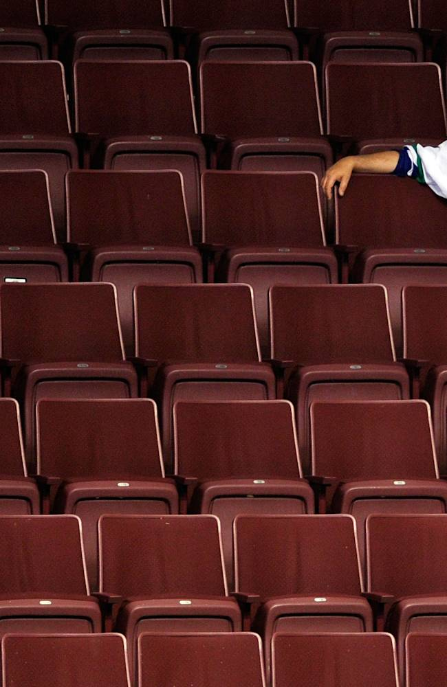 VANCOUVER, BC - JUNE 15: A Vancouver Canucks fan sits in empty seats after the Vancouver Canucks were defeated by the Boston Bruins in Game Seven of the 2011 NHL Stanley Cup Final at Rogers Arena on June 15, 2011 in Vancouver, British Columbia, Canada. The Boston Bruins defeated the Vancouver Canucks 4 to 0. (Photo by Rich Lam/Getty Images)