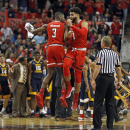 West Virginia player appears to throw punch at court-storming Texas Tech fan