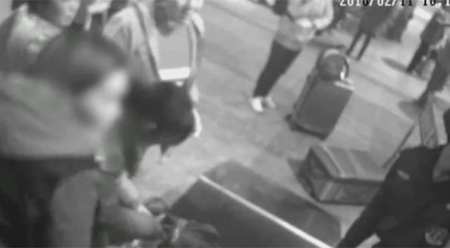 The woman reportedly didn't trust train security staff with her handbag. Source PearVideo