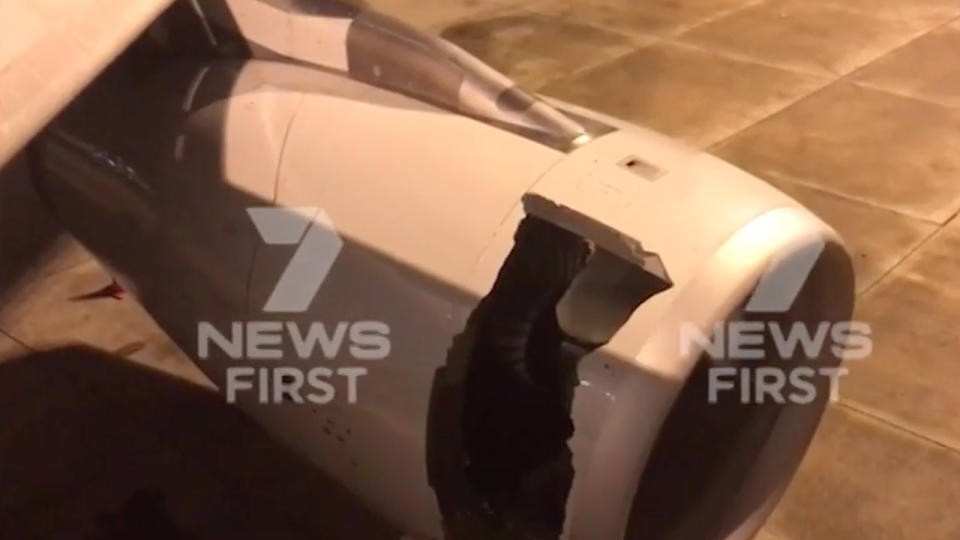 Gaping hole in engine forces Sydney landing