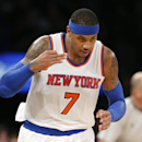 New York Knicks forward Carmelo Anthony (7) salutes the crowd after hitting a 3-point basket in the first half of an NBA basketball game against the Denver Nuggets in New York, Sunday, Nov. 16, 2014. The Knicks defeated the Nuggets 109-93. (AP Photo/Kathy Willens)