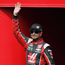 Kurt Busch waves during driver introductions for the NASCAR Sprint Cup Series auto race in Fontana, Calif., Sunday, March 22, 2015. (AP Photo/Alex Gallardo)