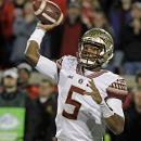 FILE - In this Oct. 30, 2014, file photo, Florida State quarterback Jameis Winston looks to pass in the first half of an NCAA college football game against Louisville in Louisville, Ky. Winston was cleared of the accusations he faced at a student code of conduct hearing involving an alleged sexual assault two years ago, according to documents obtained by The Associated Press on Sunday, Dec. 21, 2014. (AP Photo/Garry Jones, File)