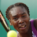 Venus Williams of the U.S. returns in the first round match of the French Open tennis tournament against Sloane Stephens of the U.S. at the Roland Garros stadium, in Paris, France, Monday, May 25, 2015. (AP Photo/Michel Euler)