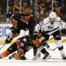 Los Angeles Kings' Jarret Stoll, right, collides with Anaheim Ducks' Corey Perry, top center, during the second period of an NHL hockey game, Friday, Feb. 27, 2015, in Anaheim, Calif. (AP Photo/Jae C. Hong)