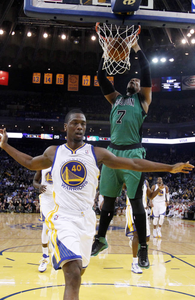 Curry's shot lifts Warriors over Celtics, 99-97
