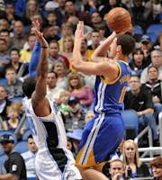 ORLANDO, FL - DECEMBER 31: Klay Thompson #11 of the Golden State Warriors attempts a shot against Jameer Nelson #14 of the Orlando Magic on December 31, 2013 at Amway Center in Orlando, Florida. (Photo by Fernando Medina/NBAE via Getty Images)