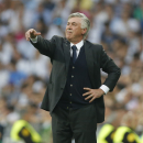 Real Madrid's coach Carlo Ancelotti gives directions to his players during the Champions League second leg semifinal soccer match between Real Madrid and Juventus, at the Santiago Bernabeu stadium in Madrid, Wednesday, May 13, 2015. (AP Photo/Daniel Ochoa de Olza)